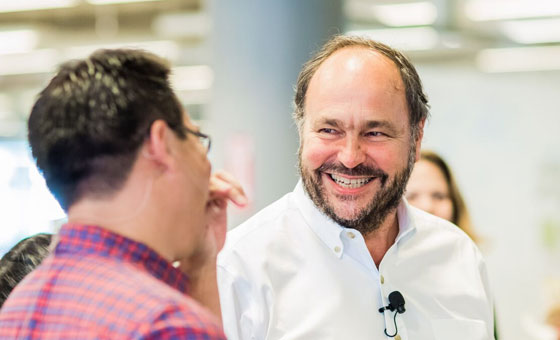 Paul Maritz, Pivotal CEO, smiling and engaging in conversation