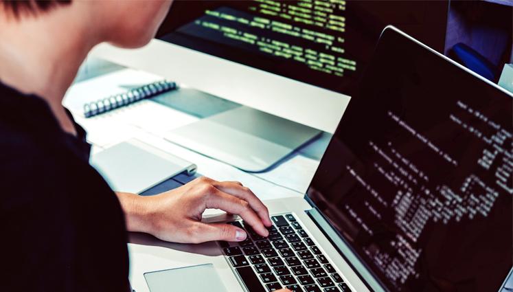 Software developer on laptop