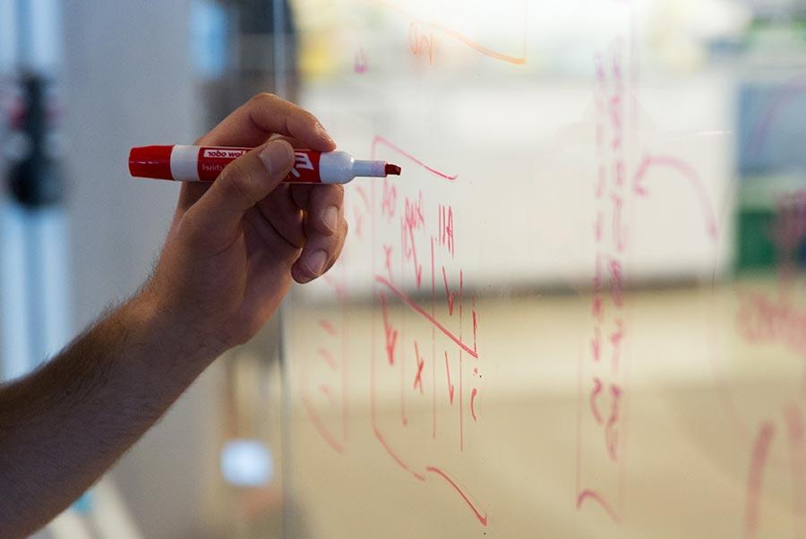Writing on glass whiteboard.